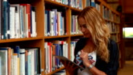 Student using tablet in library video