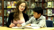 Student with teacher in Library video
