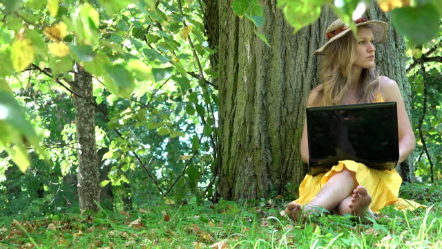 student woman work with laptop computer in nature green park. FullHD video
