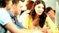 Students and Caucasian tutor networking online in hub video