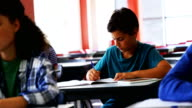 Students doing classwork in classroom video