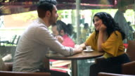 Young couple student enjoying coffee at cafe video