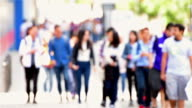Students entering campus abstract video