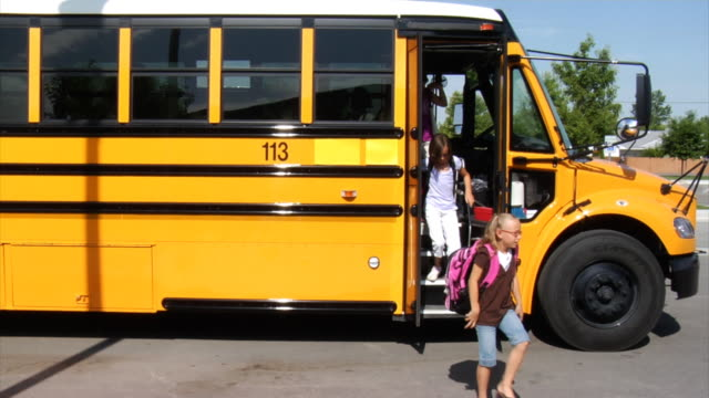 Students getting off school bus video