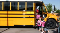 Students getting on school bus video