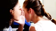 Students gossiping during class in classroom video