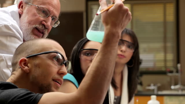 Students learning chemistry video