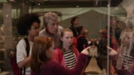Students Look At Objects In Cases On Museum Trip Shot On R3D video