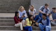 Students relaxing together between lessons video