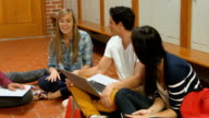 Students sitting on the floor and talking video