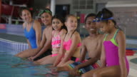 Students Sitting with Swim Instructor video