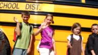 Students standing in front of school bus video
