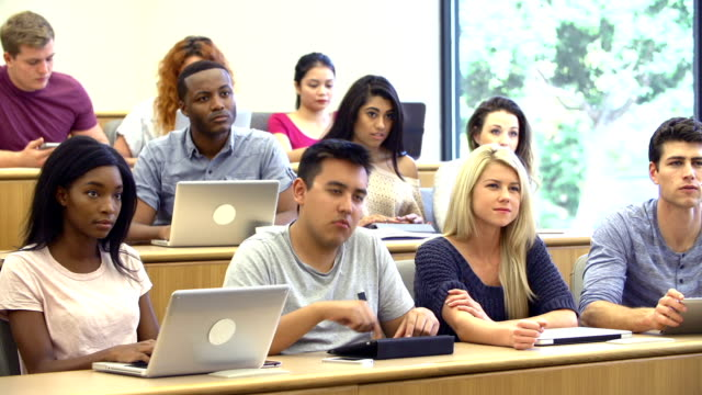 Students Using Laptops And Digital Tablets In Lecture video