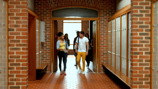 Students walking down hallway to locker video