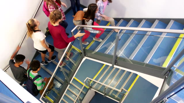 Students Walking up School Staircase video