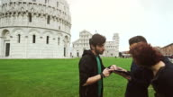 Students with a digital guide of Piazza dei Miracoli video