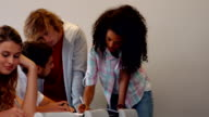 Students working and taking notes together in class video