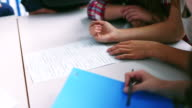 Students working in school together video