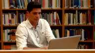 Students working together in the library video
