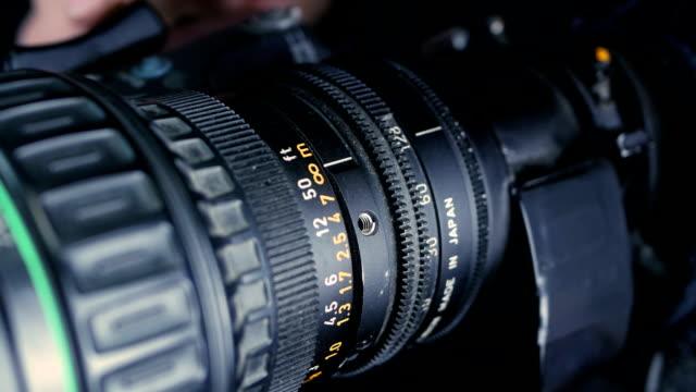 Studio camera. Cameraman changing camera settings focal length, aperture and zoom preparing for shooting video