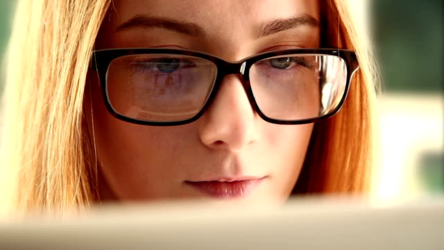 Studying online, young woman wearing glasses. video
