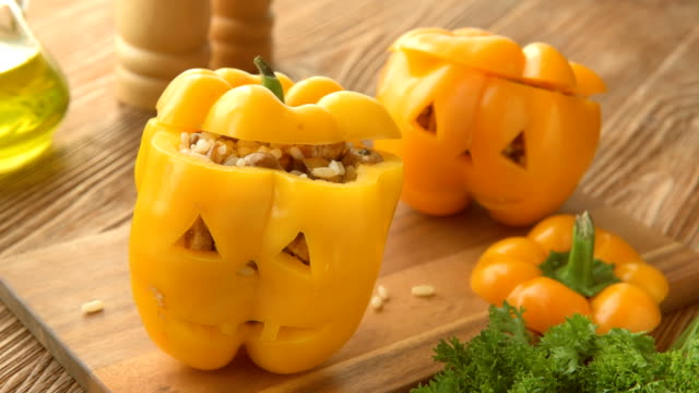 Stuffed orange pepper with meat, rice and vegetables. video