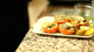 Stuffed tomatoes placed on a plate video