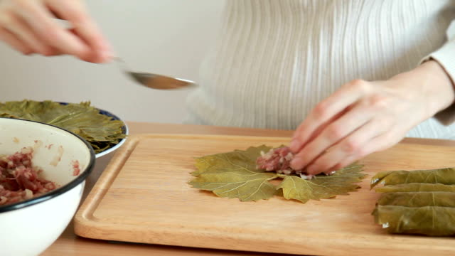 stuffing process of Grape Leaves video