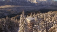 Stunning Aerial Floating Over Tall Mountain Lookout Tower Facing Massive Peaks video