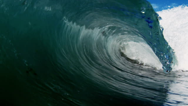 Stunning barreling wave POV as wave breaks over camera on shallow sand beach in the California summer sun. Shot in slowmo on the Red Dragon at 300FPS. video
