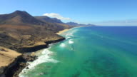 AERIAL: Stunning Cofete beach with vulcanoes and emerald ocean video