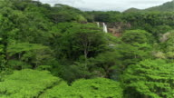 AERIAL: Stunning jungle waterfall inside big majestic primeval rainforest video