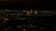 AERIAL: Stunning shimmering New Jersey and Downtown Manhattan skyline at night video