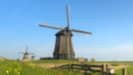 CLOSE UP: Stunning traditional wooden windmill in lowland grassy countryside video