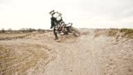 SLO MO Stunt dirt biker drifting through the turn video