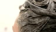 Styling hair bradded with dye hero shot video