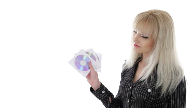 Stylish businesswoman with disks with video, music, or data video