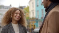 Stylish Young Couple Talking On City Street video
