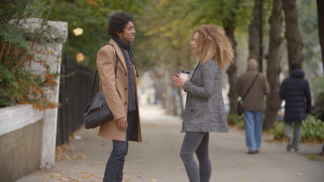 Stylish Young Couple Talking On Fall Street In City video
