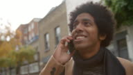 Stylish Young Man Making Phone Call On City Street video