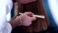Stylist at work. Hairdresser works. Hands male stylist video