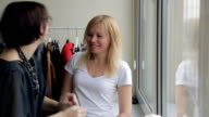 Stylist defines hair color of client to pick up clothes correctly video