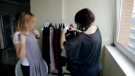 Stylist selects evening dress for beautiful blondes video