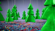 Stylized forest full of colorful candy. The concept of the Christmas holiday. video