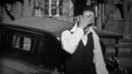 1933: Suave man wearing white collared shirt gets embarrassed. video