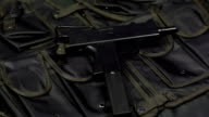 Submachine gun against the background of the vest video