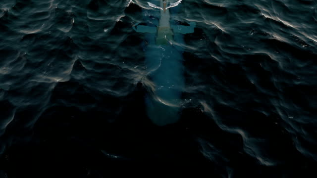 Submarine patrolling just below the water's surface video