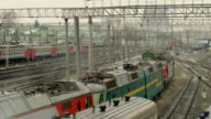 Suburban electric trains are going to the station. video