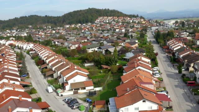 AERIAL: Suburban row houses in sunny neighborhood video