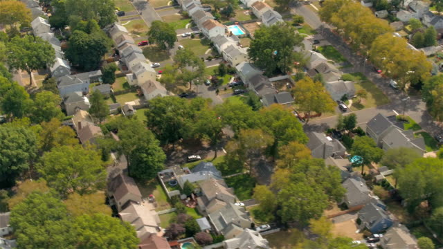 AERIAL: Suburban rowhouses and twin houses in beautiful New York neighborhood video